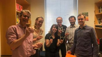 Lab members show off their ring toss skills